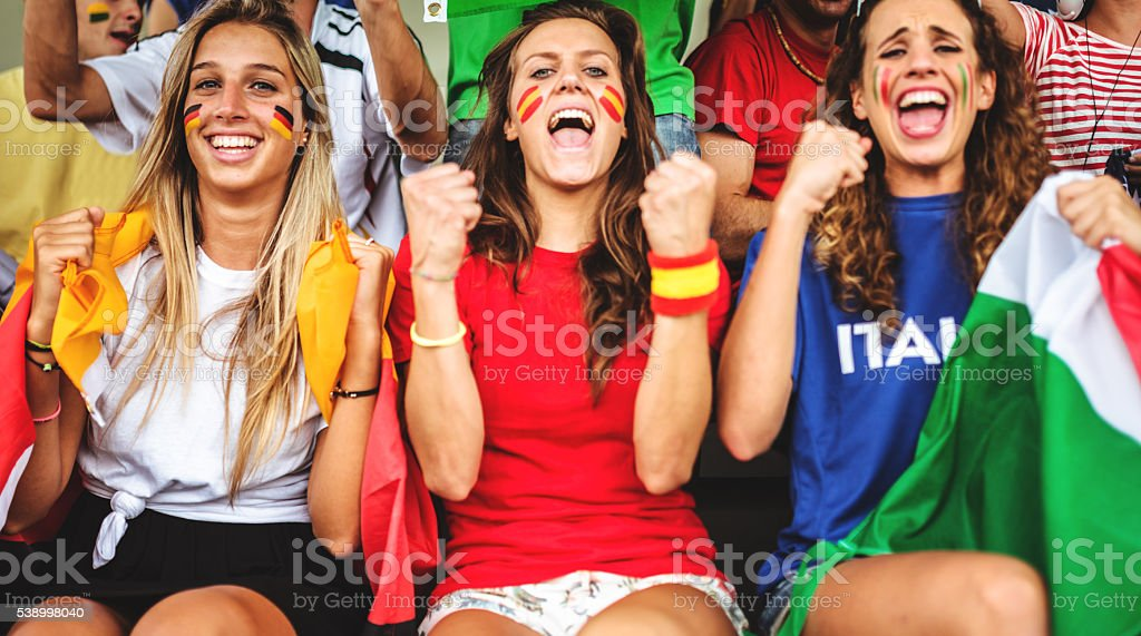 mixed national world supporter at the soccer stadium stock photo