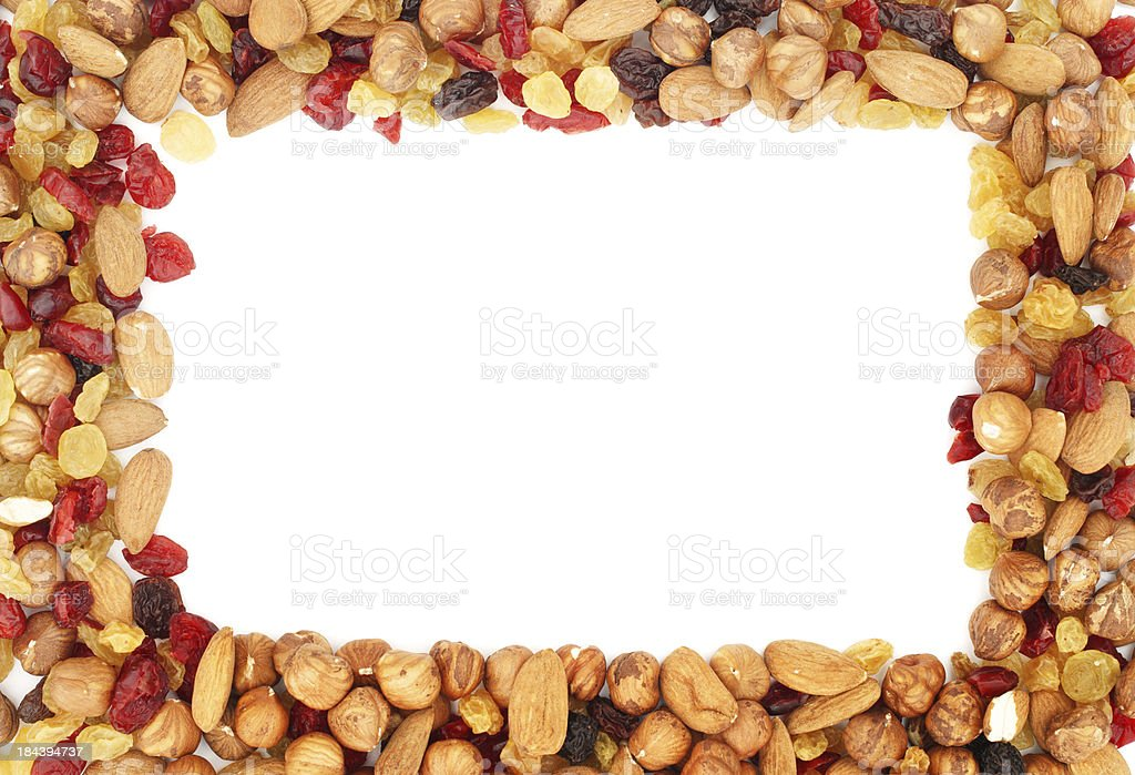 Mixed nuts and dry fruits frame on white background stock photo