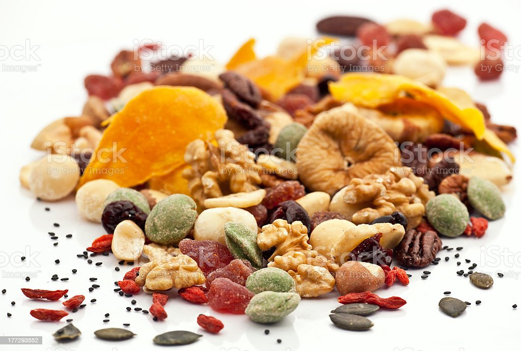Mixed nuts and dry fruits over white background stock photo