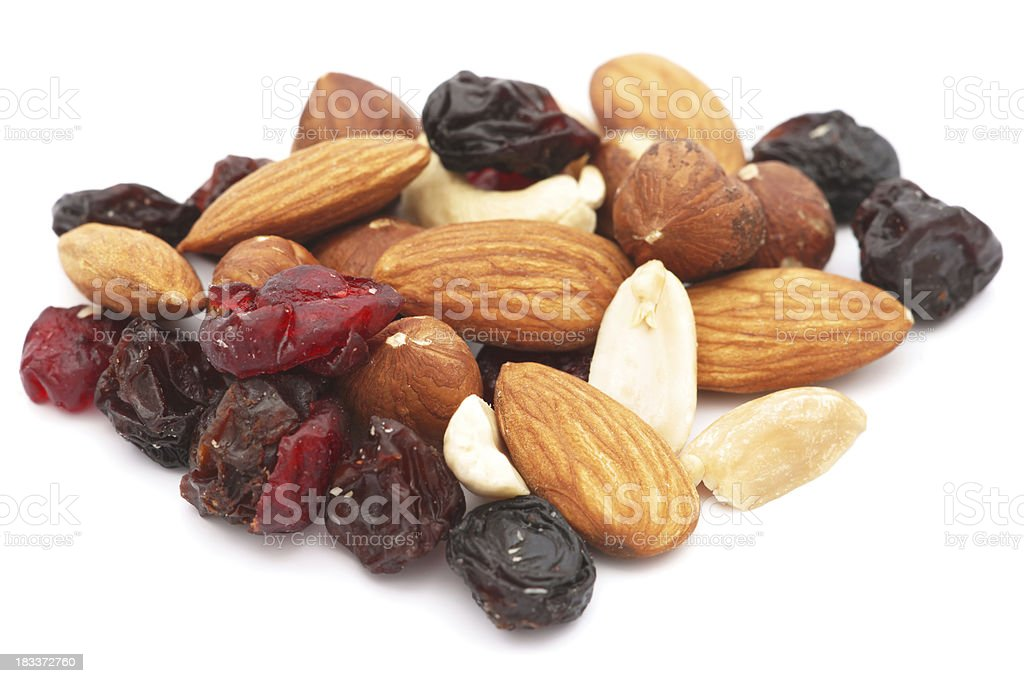 Mixed nuts and dry fruits pile isolated on white stock photo