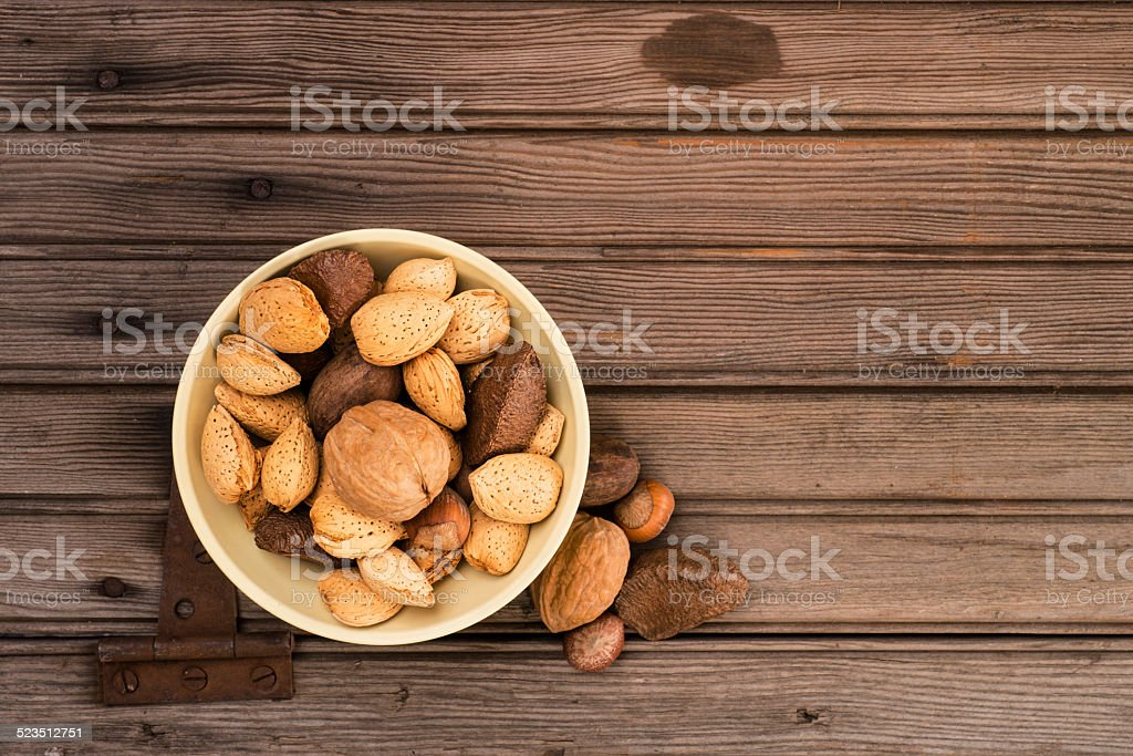 Mixed Nuts on Rustic Wood Background stock photo