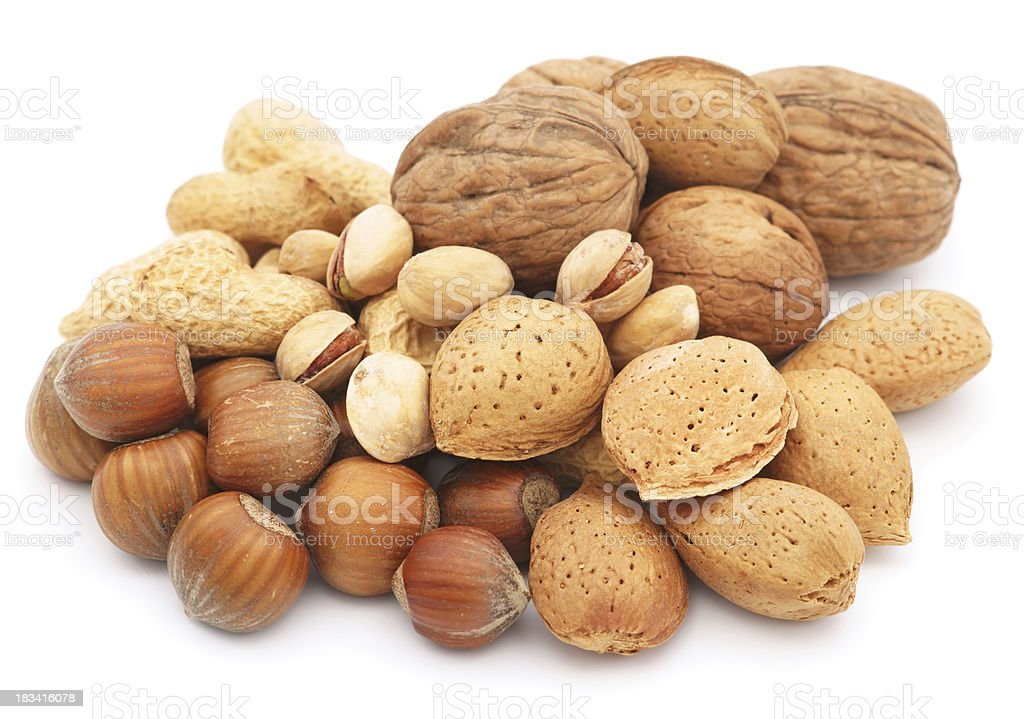 Mixed nuts pile isolated on white stock photo
