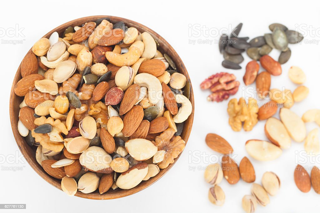 Mixed nuts top view in wooden bowl stock photo