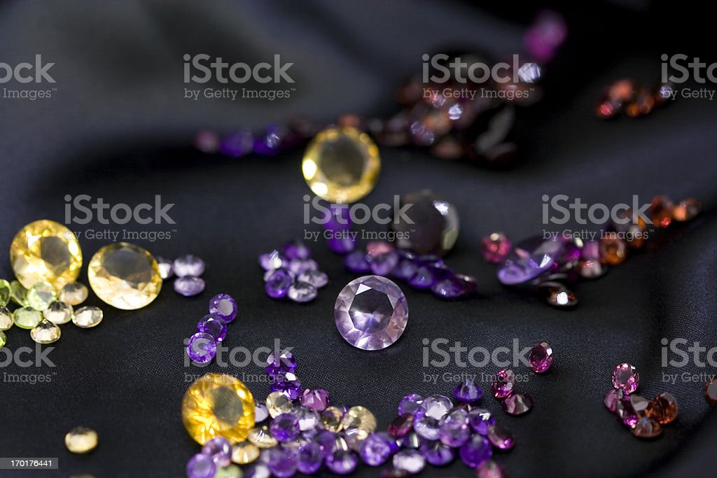 Mixed of colorful polished gemstones on the black background. royalty-free stock photo