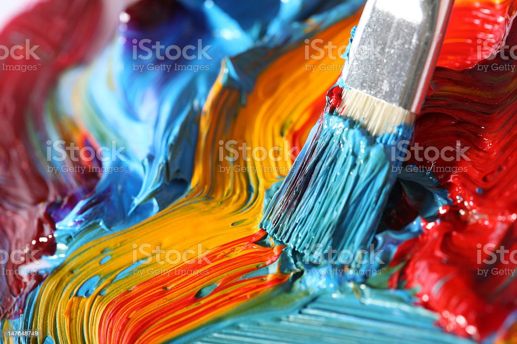 mixed oil paint with paintbrush stock photo