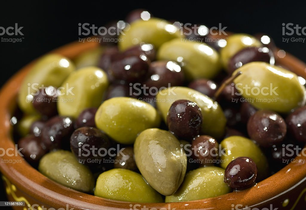 Mixed olives on black background stock photo