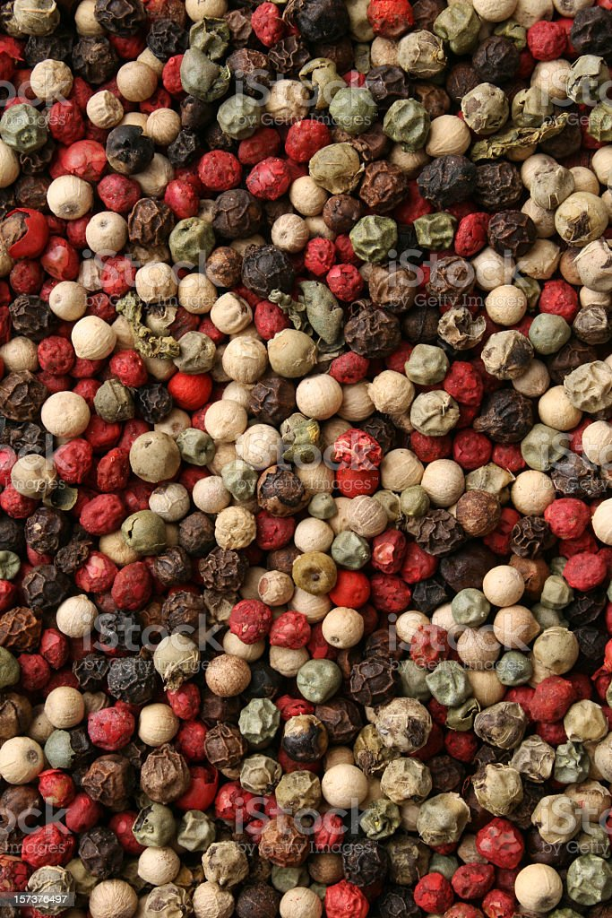 Mixed peppercorns background stock photo