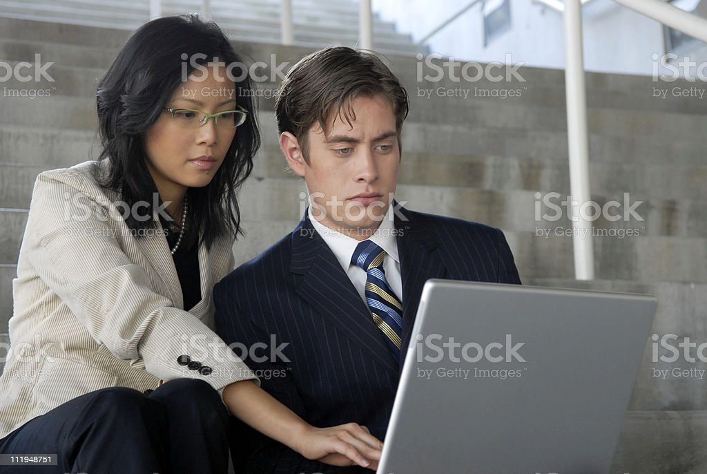 Mixed Race Asian and Caucasian Businessman Businesswoman royalty-free stock photo