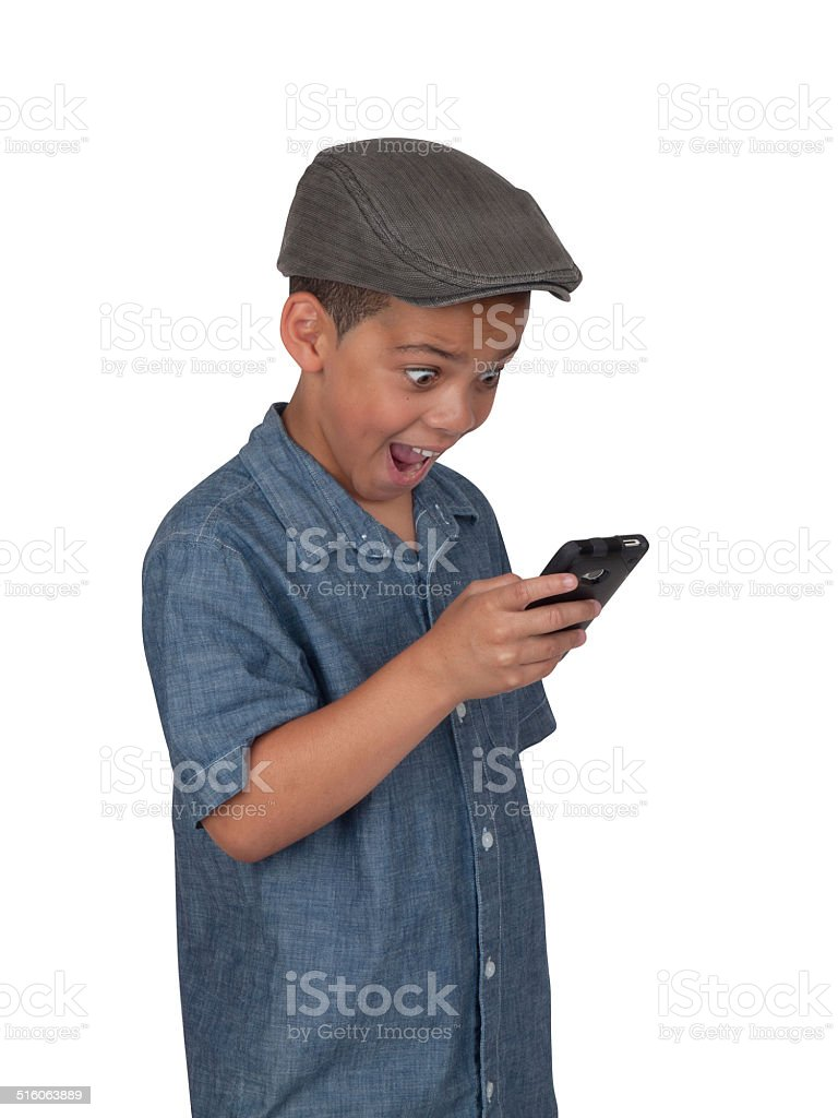 Mixed race boy with cellular phone stock photo