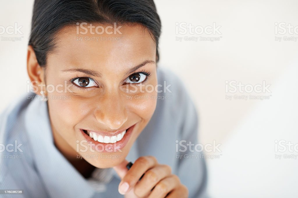 Mixed race business woman smiling at work stock photo