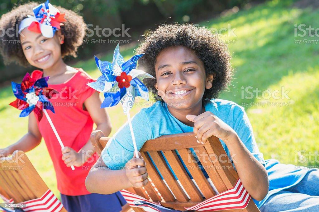 Mixed race children celebrating American holiday stock photo