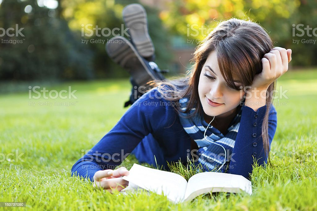Mixed race college student studying stock photo