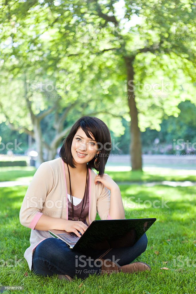 Mixed race college student with laptop royalty-free stock photo