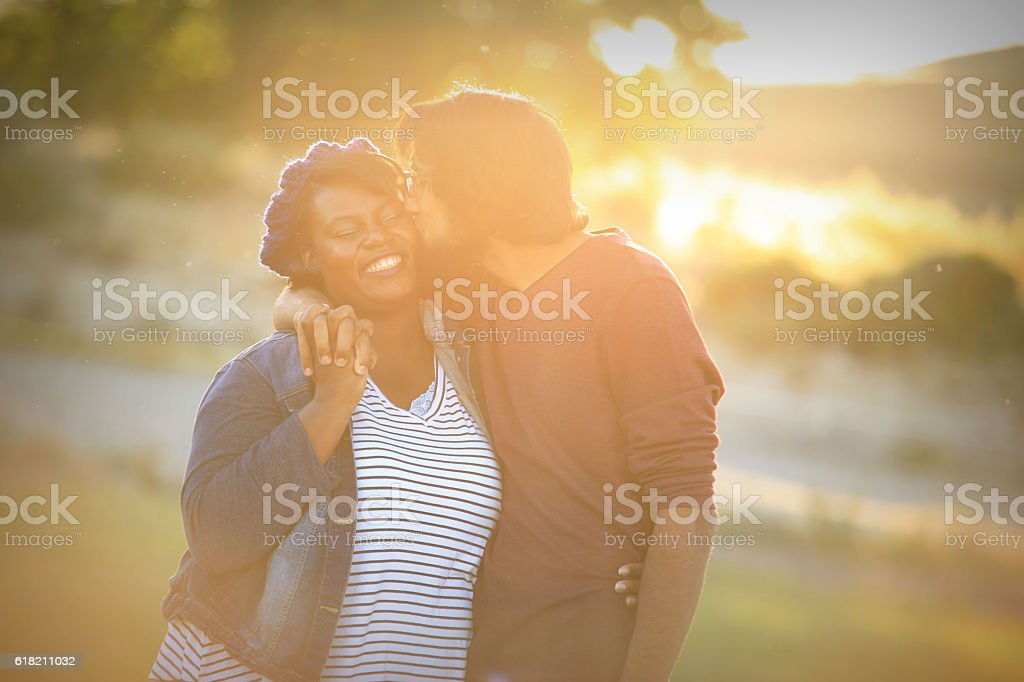 Mixed Race Couple Cute Kissing at Suset stock photo