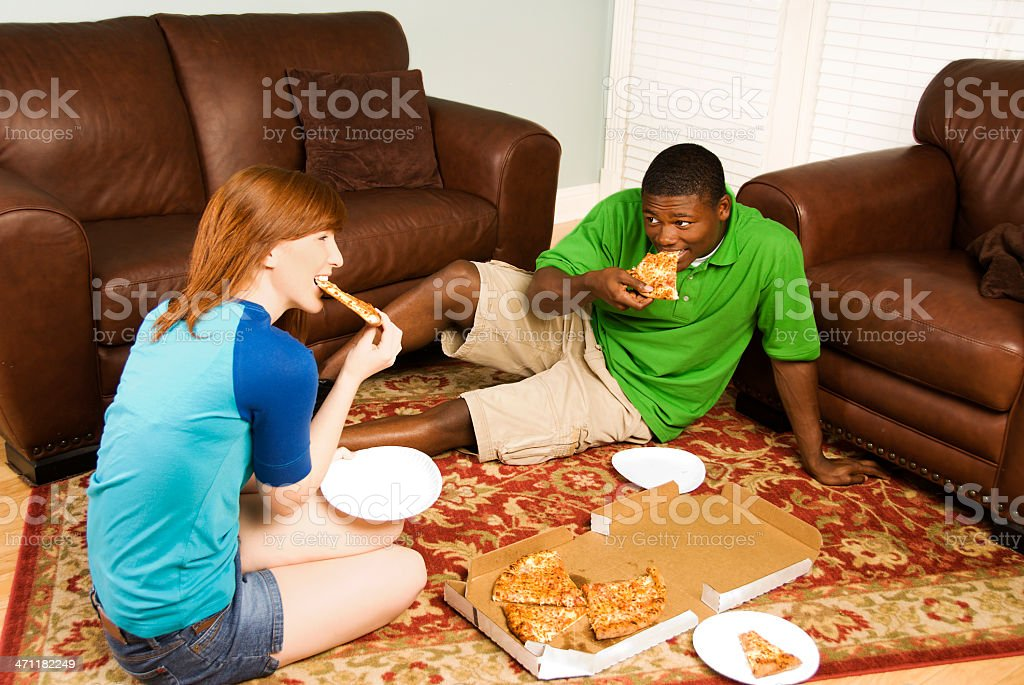 Mixed Race Couple eating pizza royalty-free stock photo