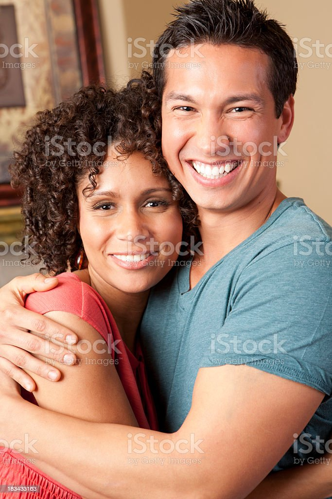 Mixed race couple holding each other royalty-free stock photo