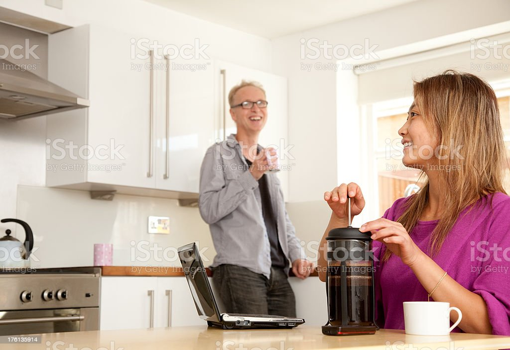 Mixed race couple in modern kitchen royalty-free stock photo