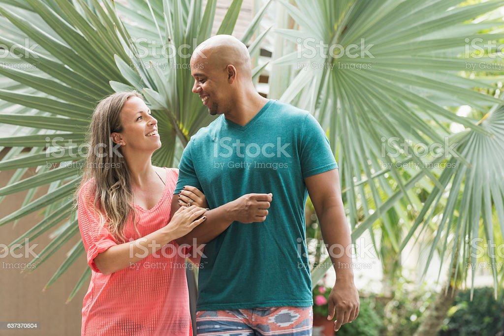 Mixed race couple on romantic vacation stock photo