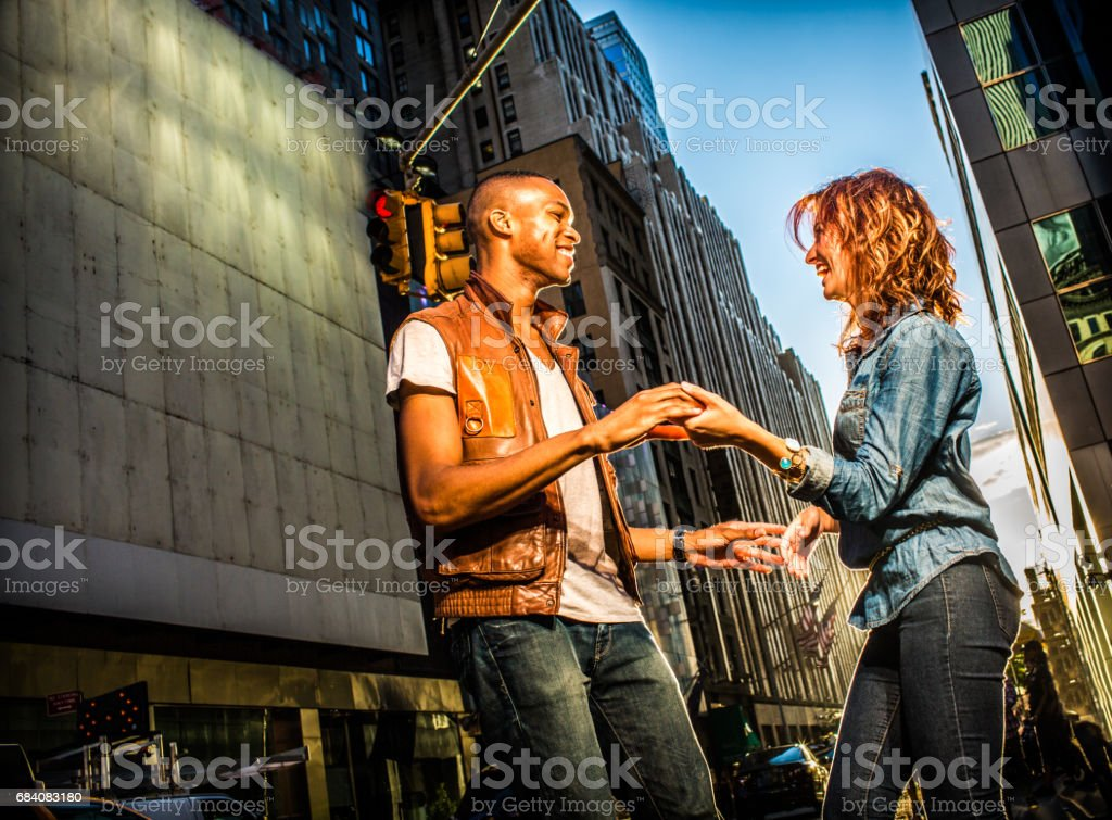 Mixed race couple walking around in New York City stock photo