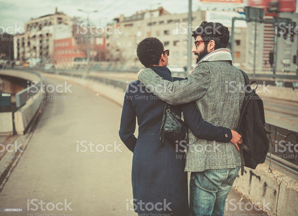 mixed race couple  walking on the street stock photo
