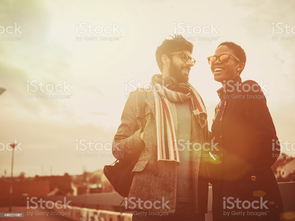 mixed race couple  walking on the street stock photo