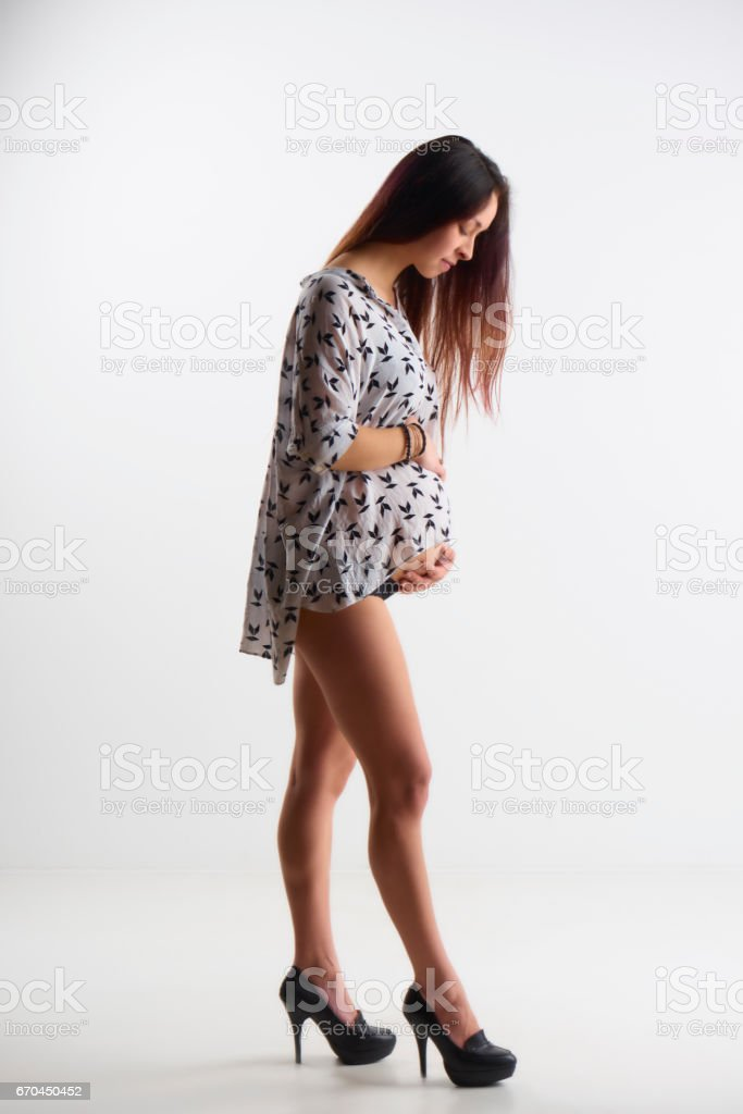 Mixed race ethnicity pregnant woman in high heels stock photo