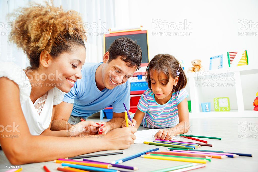 Mixed Race Family Coloring and Drawing. stock photo