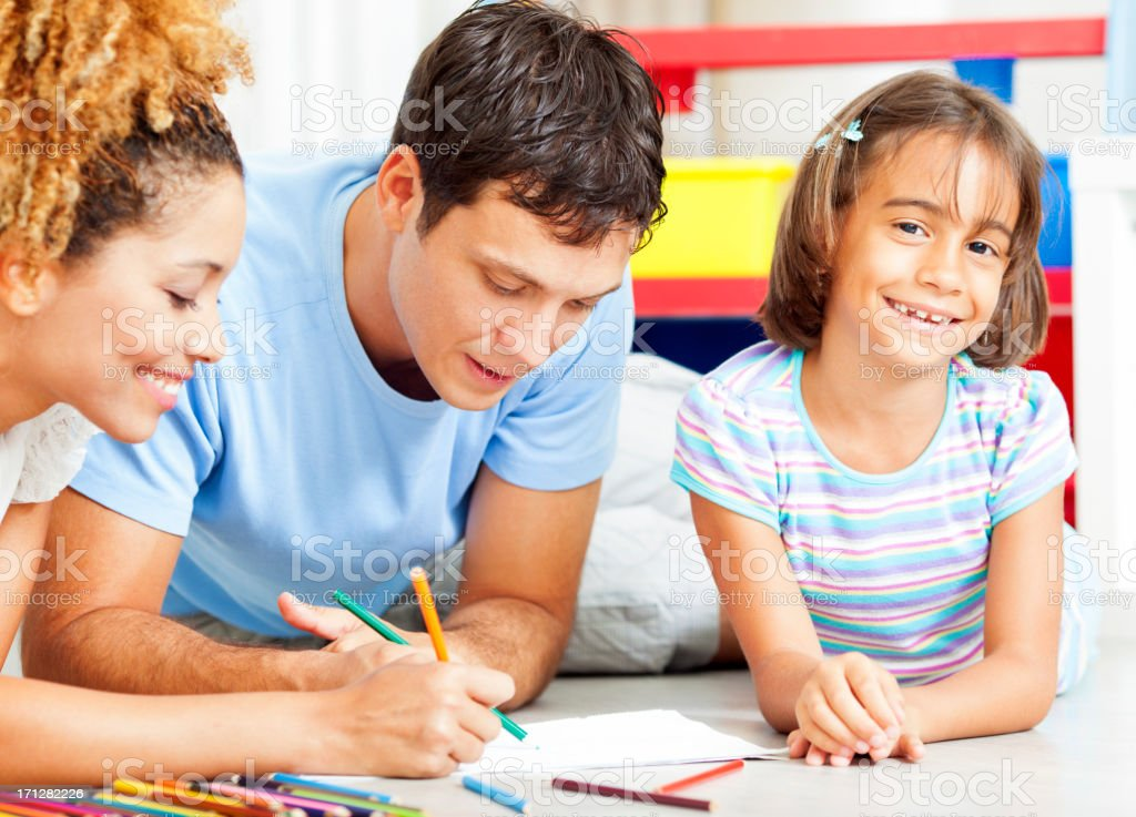 Mixed Race Family Coloring and Drawing stock photo