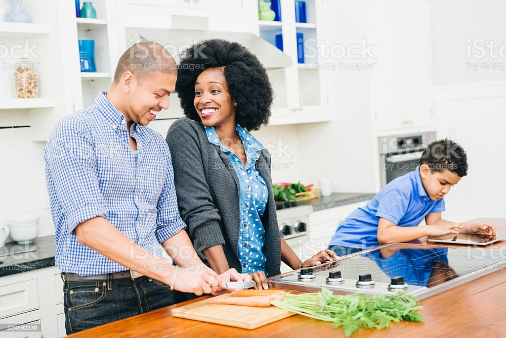 Mixed Race Family in the kitchen stock photo