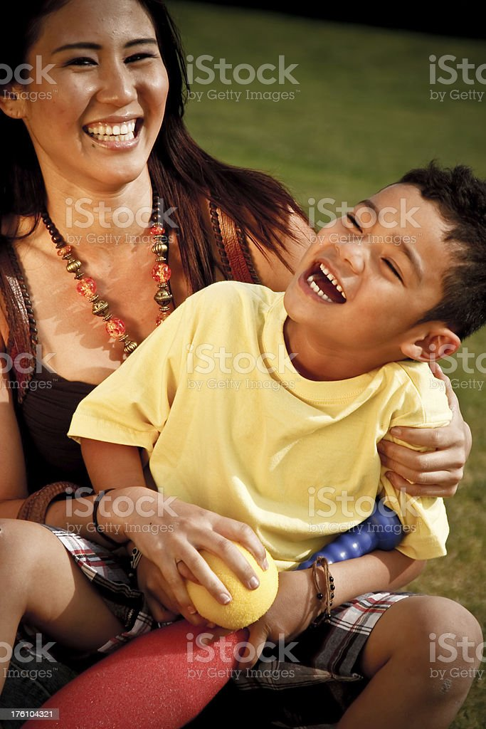 Mixed Race Family Playing stock photo