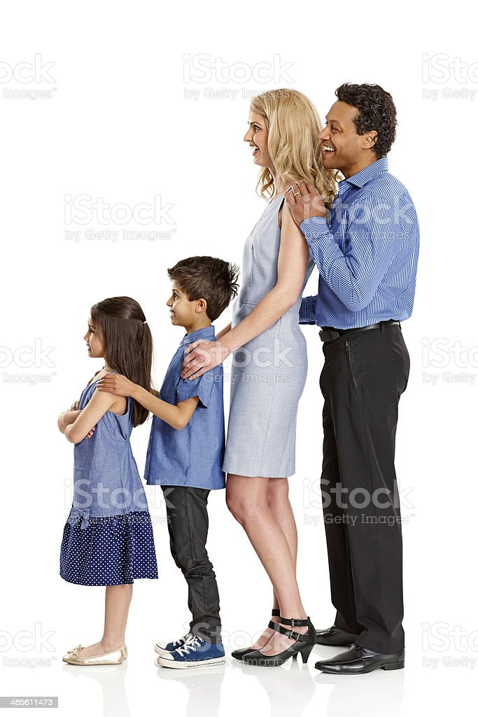 Mixed race family standing in line looking away at copyspace royalty-free stock photo