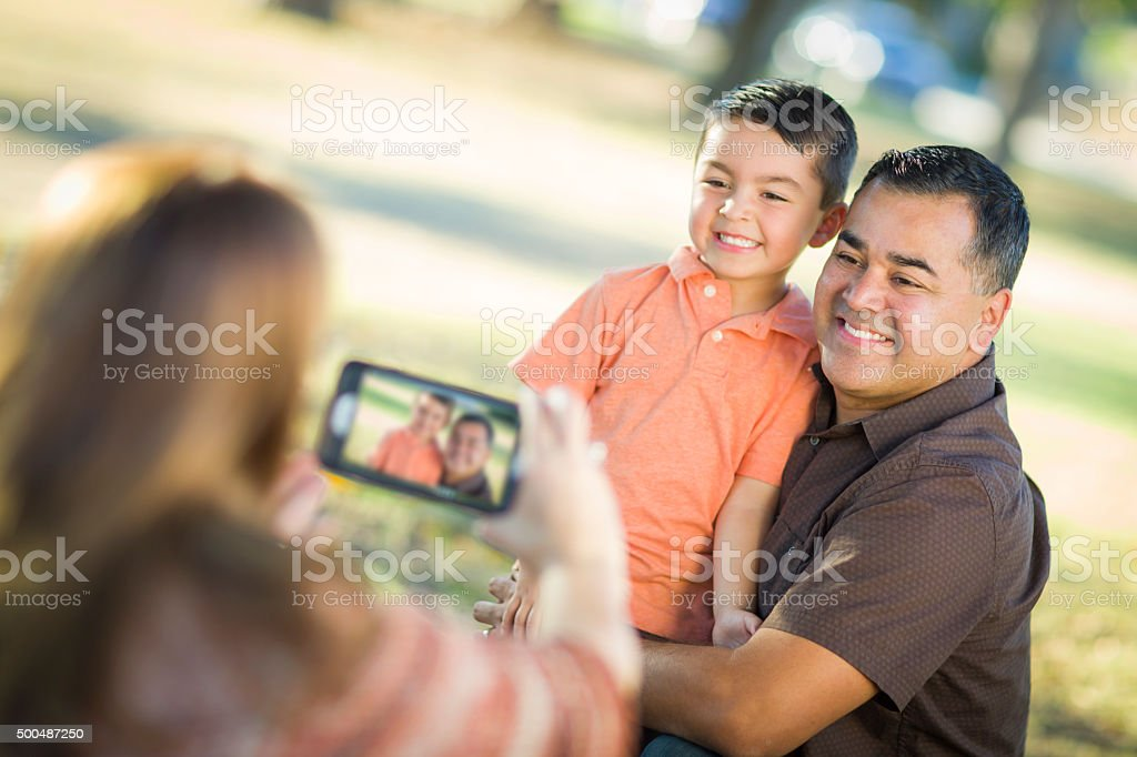 Mixed Race Family Taking A Selfie Phone Camera Picture stock photo