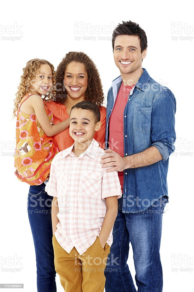 Mixed race family together smiling against white royalty-free stock photo