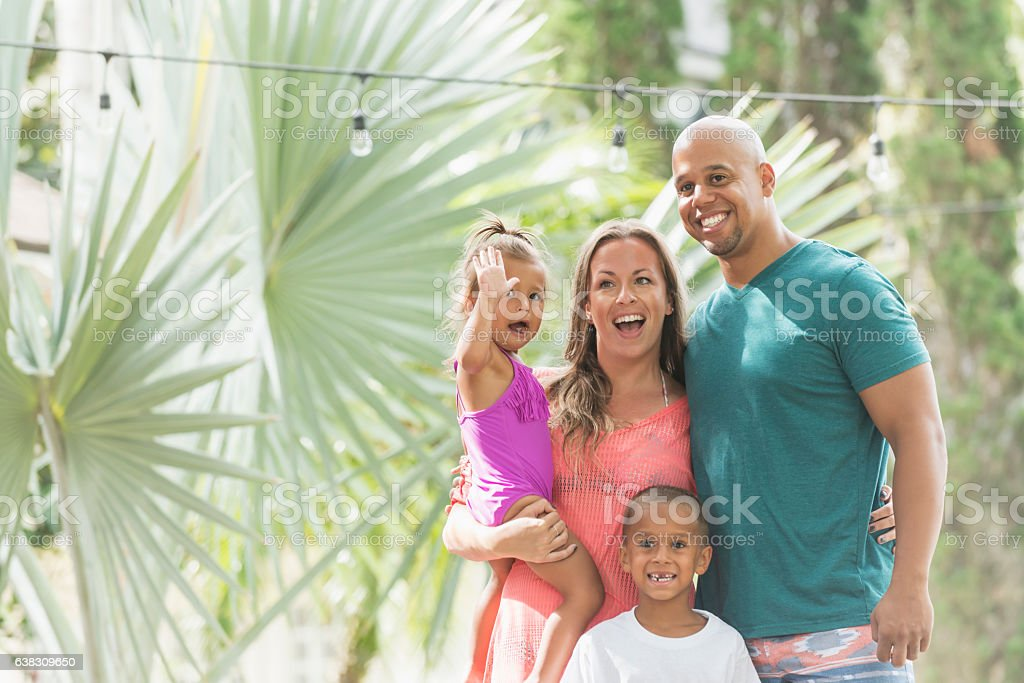 Mixed race family with children on tropical vacation stock photo