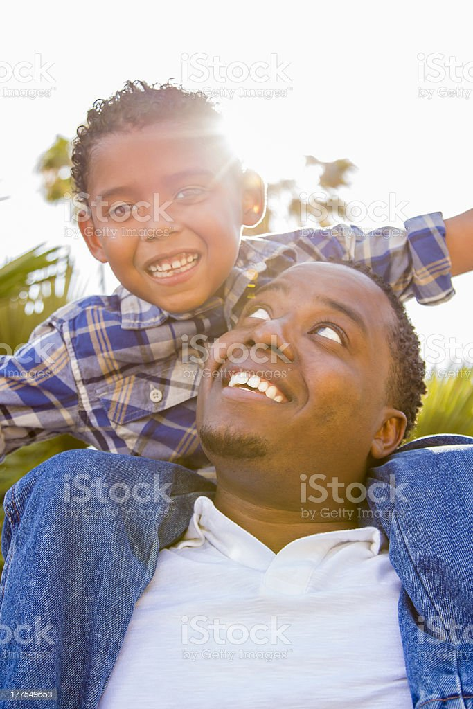 Mixed Race Father and Son Playing Piggyback royalty-free stock photo