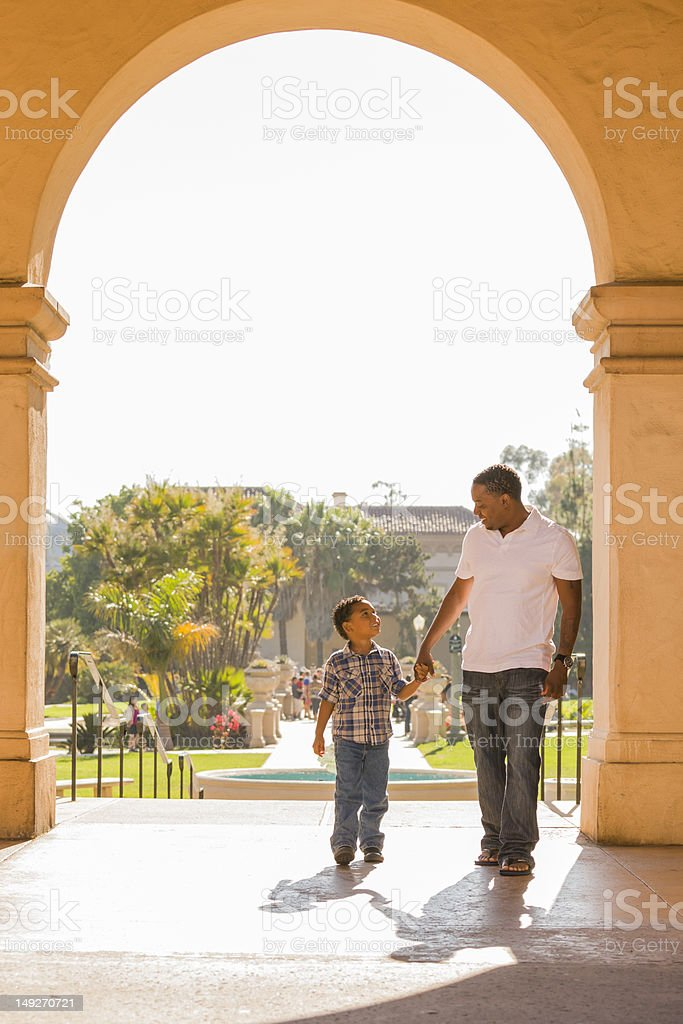 Mixed Race Father and Son Walking in the Park royalty-free stock photo
