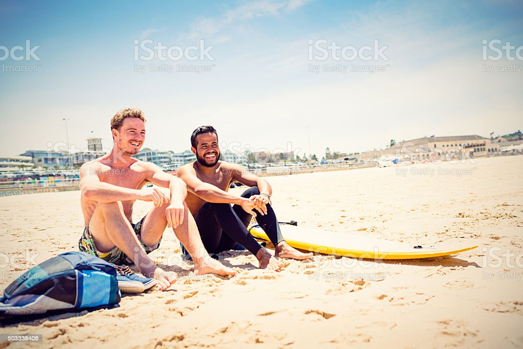 Mixed race friends with surfboard at Bondi Beach, Australia stock photo
