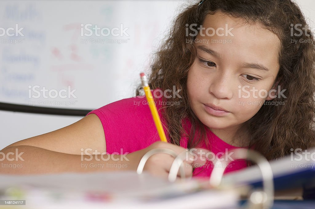 Mixed Race Girl Doing Homework stock photo