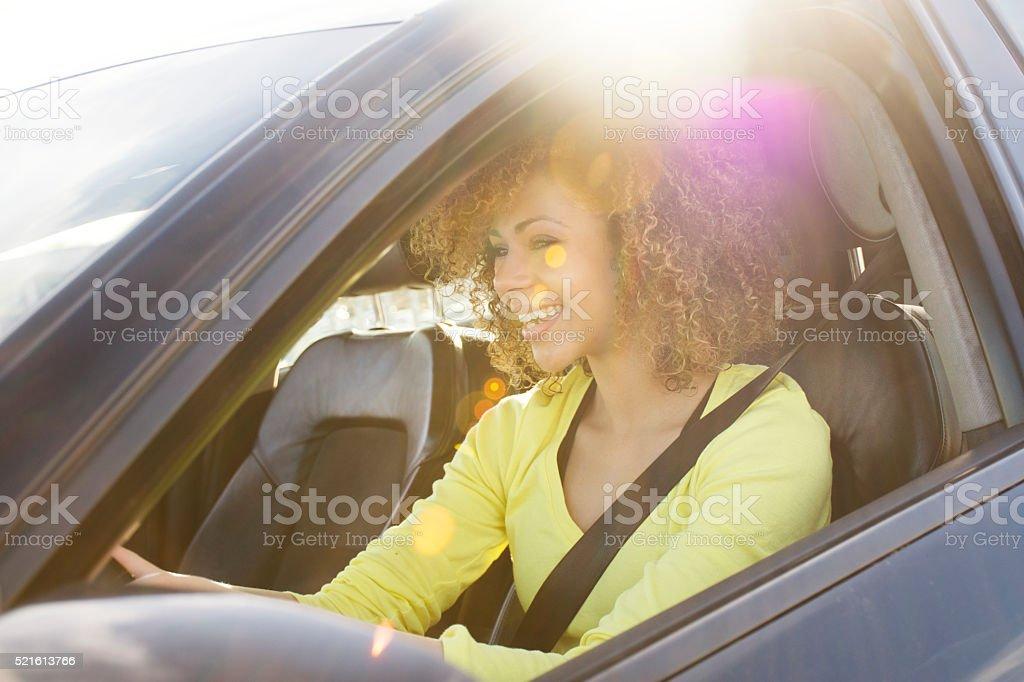 MIxed race girl driving a car stock photo