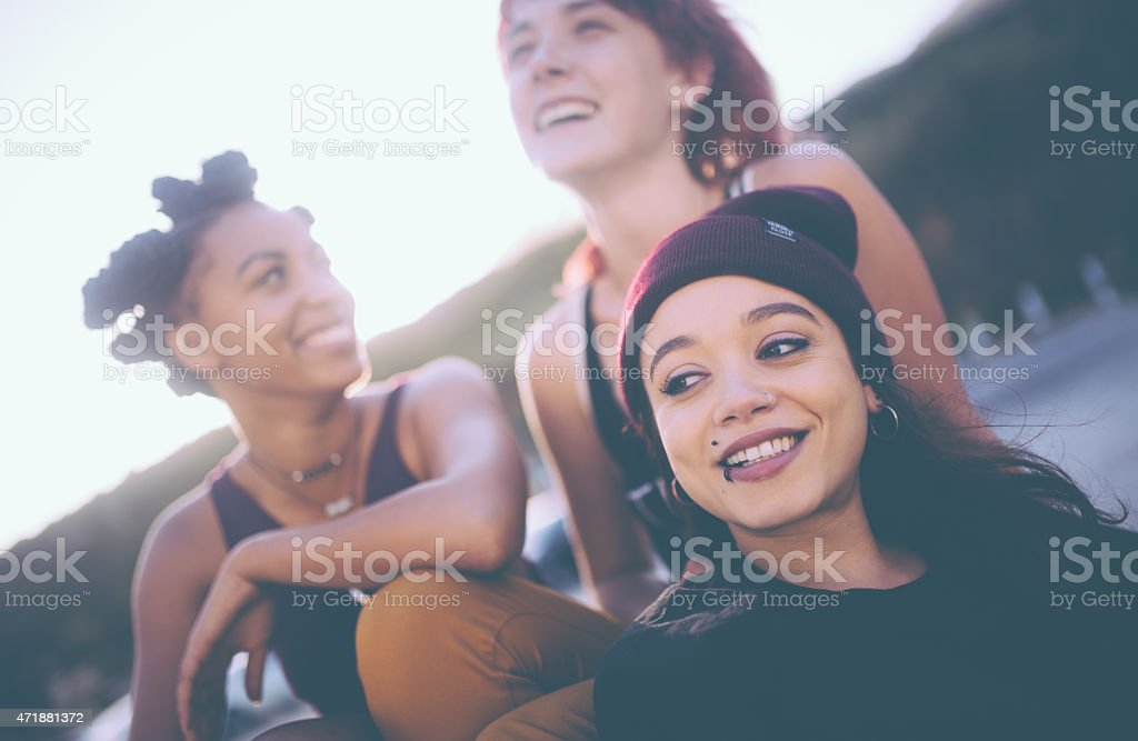 Mixed race group of grunge girls hanging out together stock photo