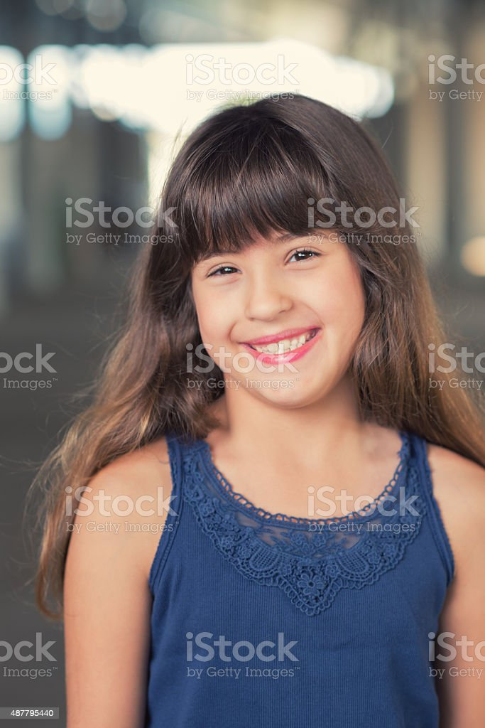 Mixed race Hispanic and Caucasian little girl smiling outdoors stock photo