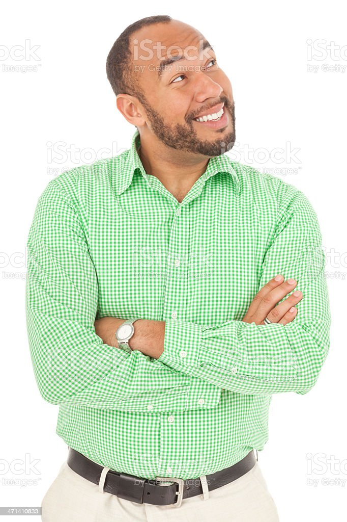 Mixed Race Man Looking Up Smiling stock photo