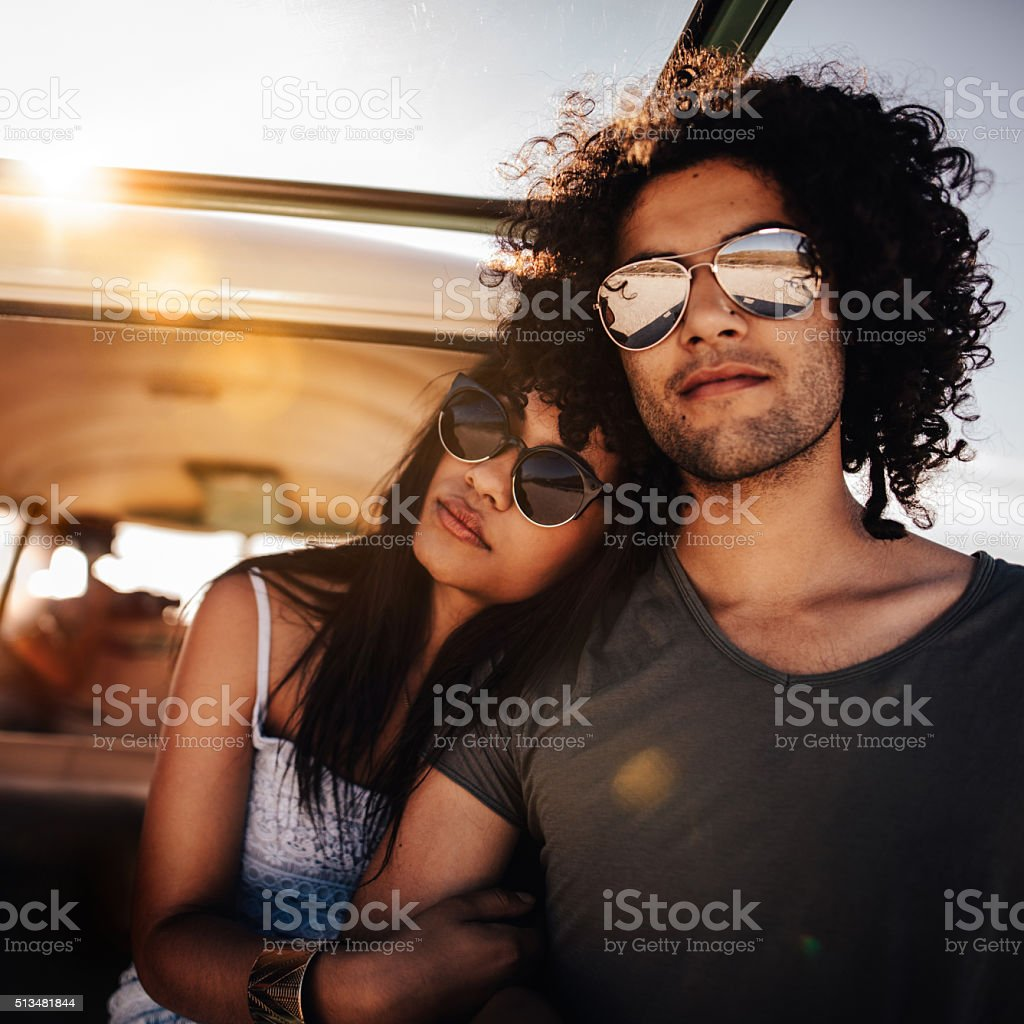 Mixed Race Person Hipster Friends Sitting at Sunset in van stock photo