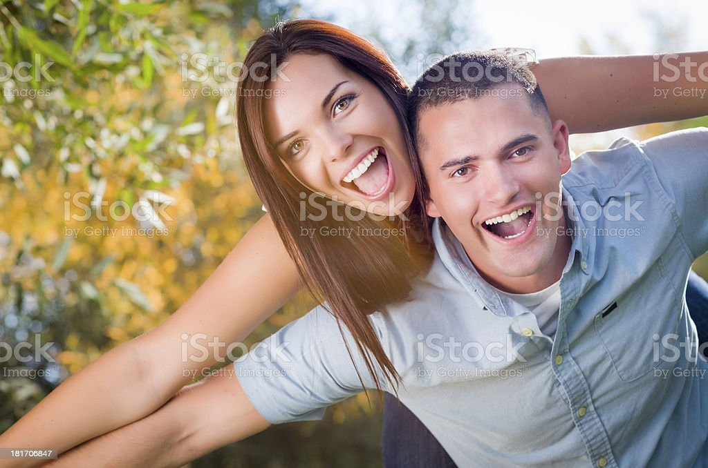 Mixed Race Romantic Couple Portrait in the Park royalty-free stock photo