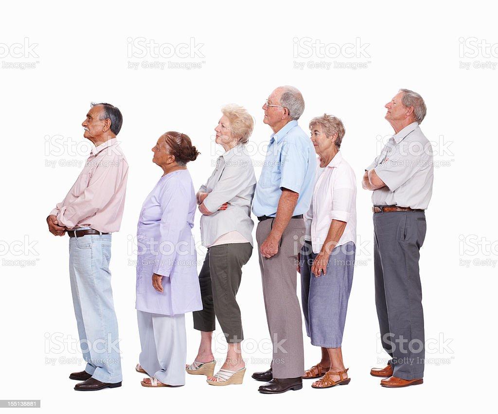 Mixed race seniors queuing royalty-free stock photo