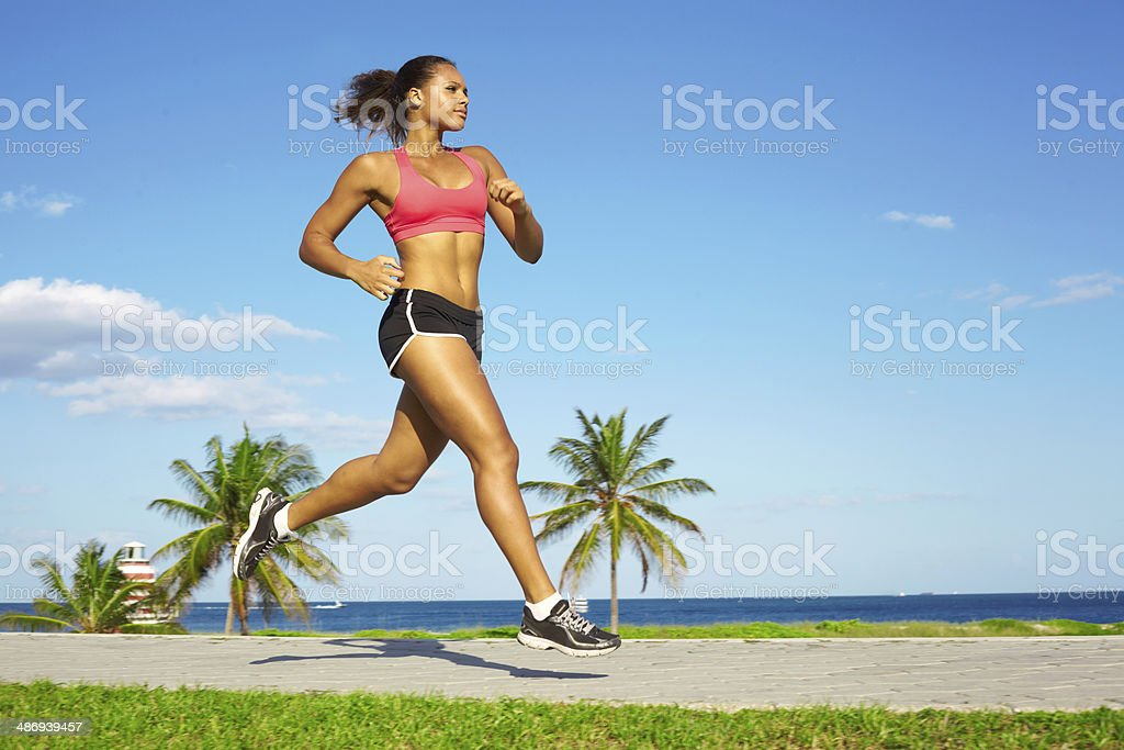 Mixed Race Woman Jogging stock photo