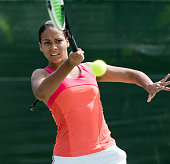 Mixed race Woman Playing Tennis