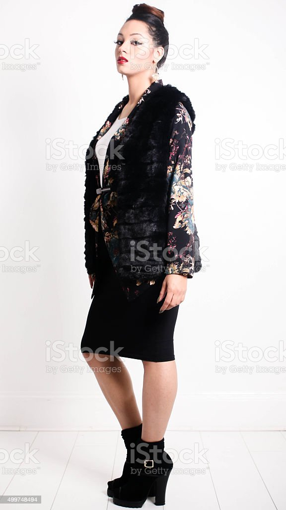 Mixed Race Women looking to the side in Winter Fashion stock photo
