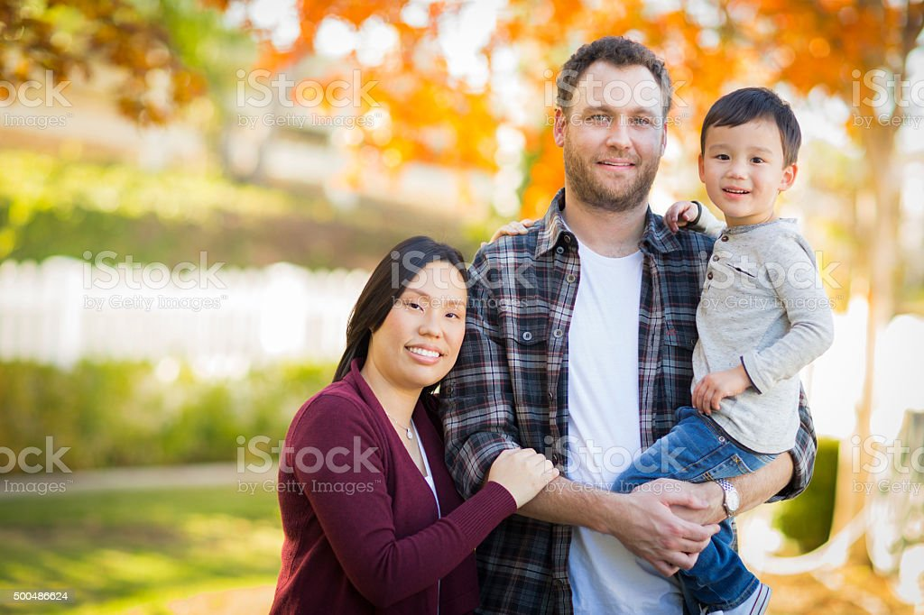 Mixed Race Young Family Portrait Outdoors stock photo