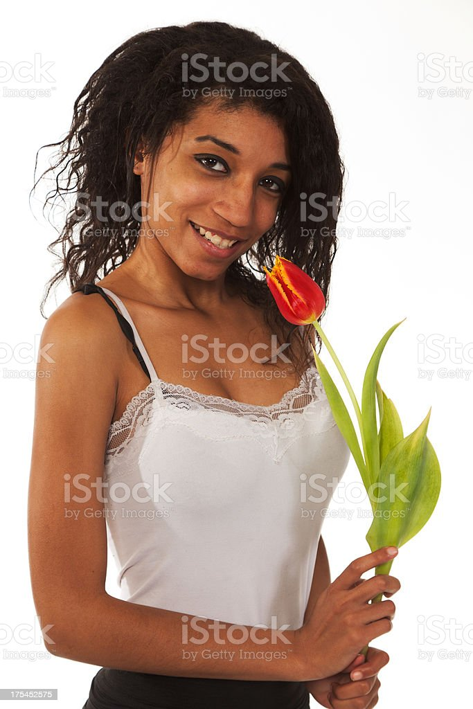Mixed race young woman with flower stock photo